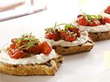 Creamy White Bean & Roasted Garlic Crostini with Smoky Tomato Jam