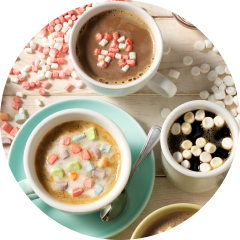 Top view of three cups of hot chocolate topped with KRAFTdehydrated marshmallow bits