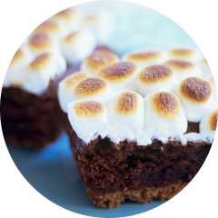 Close up of two chocolate brownies frosted with KRAFT marshmallows