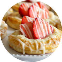 Close up view of strawberry danishes with cream cheese filling