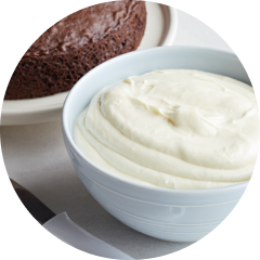 A blue bowl of cream cheese frosting