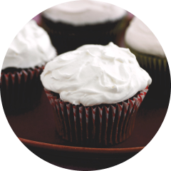 Close up of a cupcake topped with cream cheese frosting