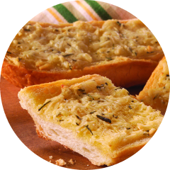 A slice of garlic bread topped with KRAFT cheese