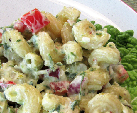 Close up of chimichurri pasta salad in a white bowl