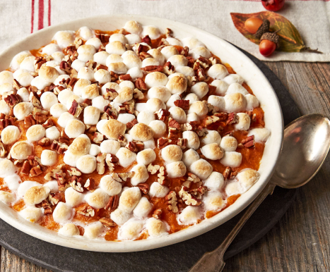 A sweet potato casserole made with KRAFT marshmallows in a white serving dish